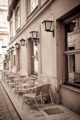 Fototapeta Stoły i krzesła w kawiarni