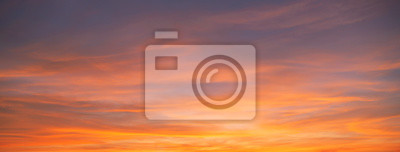 Fototapeta Sunset sky. Abstract nature background. Dramatic blue and orange, colorful clouds at twilight time.