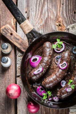Fototapeta Tasty black pudding with parsley and onion