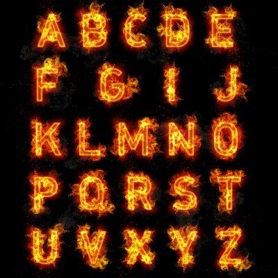 Fototapeta Tekst Fire font wszystkie litery alfabetu na czarnym tle