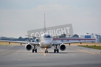 Fototapeta This is a view of LOT Polish Airlines Embraer ERJ 170 plane registered as SP-LDE on the Warsaw Chopin Airport. July 30, 2015. Warsaw, Poland.