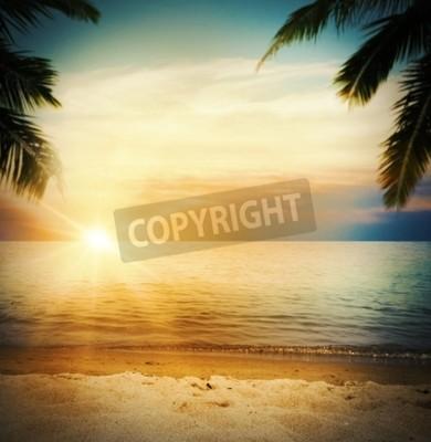 Fototapeta Tło tropikalnej plaży o zachodzie słońca