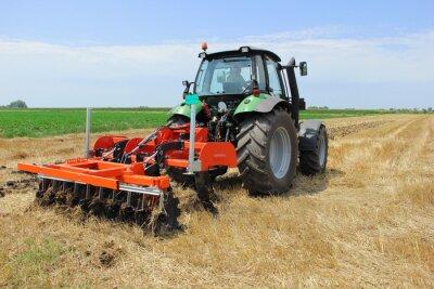 Fototapeta Tractor on the field