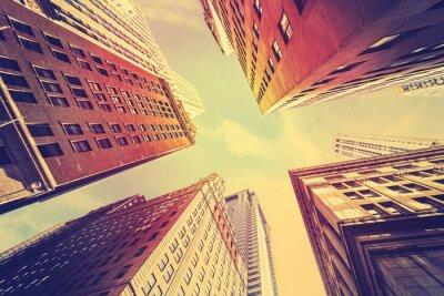 Fototapeta Vintage stonowanych drapacze chmur na Manhattanie o zachodzie słońca, NYC.