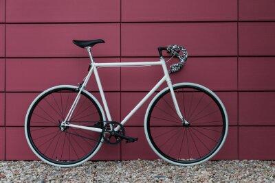 Fototapeta White fixie bike in pink wall