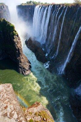 Fototapeta Widok Victoria Falls z ziemi. Mosi-oa-Tunya Park Narodowy. oraz Światowego Dziedzictwa UNESCO. Zambiya. Zimbabwe. Doskonałą ilustracją.