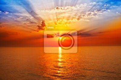 Fototapeta wschód słońca na morzu