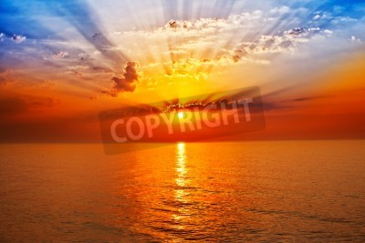 Fototapeta wschód słońca w morzu