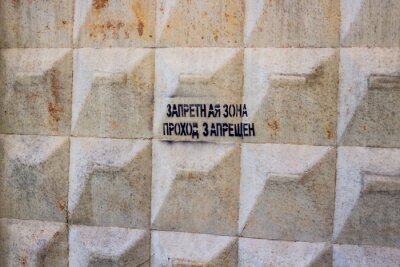 "Fototapeta Russia - August 2018: Concrete fence with the inscription ""Forbidden zone, Passage forbidden"".."