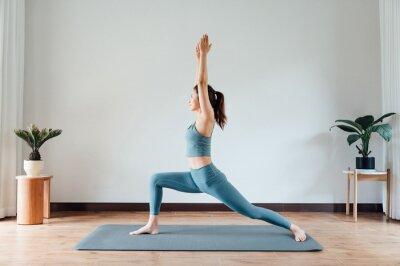 Fototapeta young asian beauty woman doing yoga at home