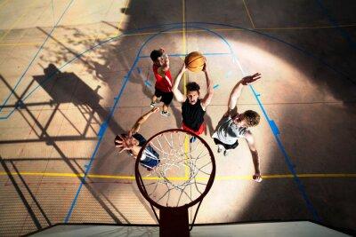 Fototapeta young basketball players playing with energy