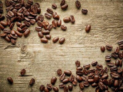 Fototapeta Ziarna kawy na drewnianym stole