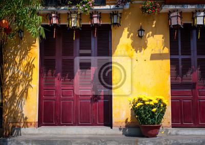 Fototapeta Żółte ściany na ulicach w starożytnego miasta Hoi An, Wietnam
