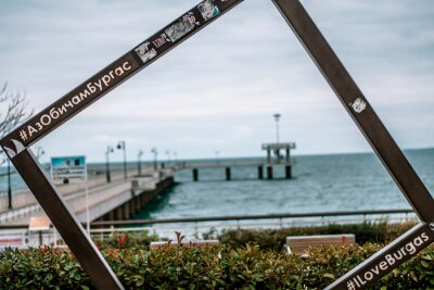 Naklejka A picture frame monument and the symbol of Burgas - Burgas sea bridge in the background. Translation on the frame is I Love Burgas.