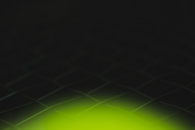 abstract of black net tennis racket and blurred tennis ball forground