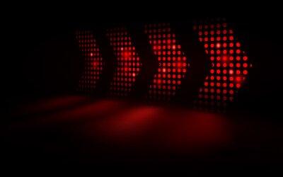 Naklejka Abstract red light arrows speed futuristic on dark background. vector illustration