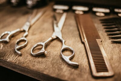 Naklejka accessories for haircuts are on the shelf in the salon