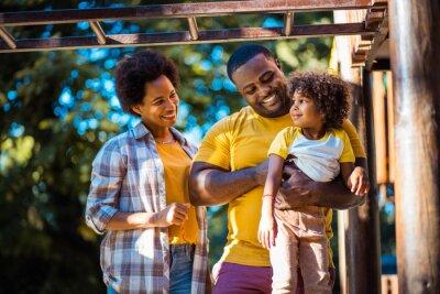 Naklejka African American family having fun outdoors.