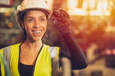Naklejka African American woman happy worker engineering working smile labor in heavy industry factory with good welfare concept.