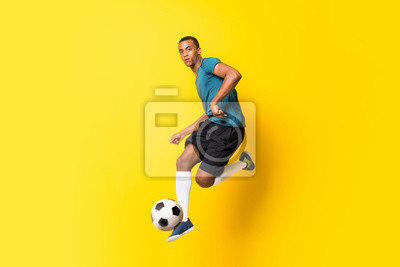 Naklejka Afro American football player man over isolated yellow background