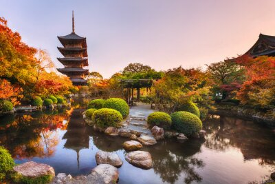 Naklejka Ancient wooden pagoda Toji temple in autumn garden, Kyoto, Japan.