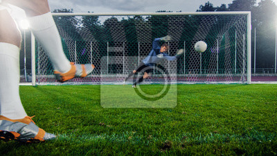 Anonymous Soccer Player Kicks Ball on Penalty, Professional Goalkeeper Stands in Goals, Jumps to Catch the Ball.
