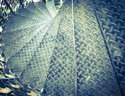 Naklejka Archiwalne tonowe schody spiralne żelaza tle