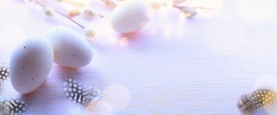 Art Happy Easter greeting card background;  Easter eggs decoration and spring flowers on light sunny background