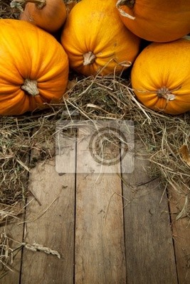 art pomarańczowe dynie na tle drewniane