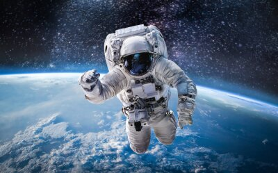 Naklejka Astronaut in the outer space over the planet Earth. Abstract wallpaper. Spaceman. Elements of this image furnished by NASA