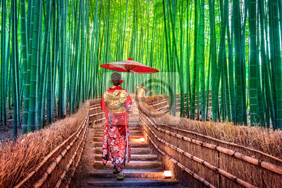 Naklejka Bamboo Forest. Asian woman wearing japanese traditional kimono at Bamboo Forest in Kyoto, Japan.