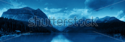Naklejka Banff national park Lake Louise sunrise panorama with mountains and forest in Canada.