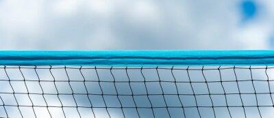 Naklejka Beach volleyball and beach tennis net on sky background. Summer sport concept