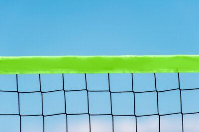 Naklejka Beach volleyball and beach tennis net on the background of blue sky with clouds. Summer sport concept.