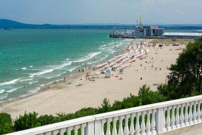 Naklejka Beautiful Black Sea landscape from Burgas, Bulgaria. Summer seascape of Burgas bay. Umbrellas and sunbeds on the beach