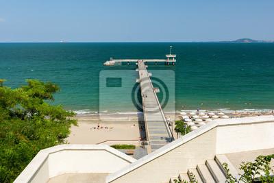 Naklejka Beautiful Black Sea landscape from Burgas, Bulgaria. Summer seascape of Burgas bay. View of Burgas bridge. Umbrellas and sunbeds on the beach