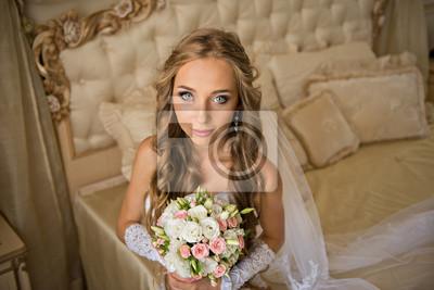 beautiful bride in her bright bedroom