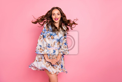 Beautiful lady overjoyed by warm breeze satisfied with romantic date wear cute dress isolated pink background