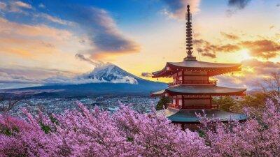 Naklejka Beautiful landmark of Fuji mountain and Chureito Pagoda with cherry blossoms at sunset, Japan. Spring in Japan.