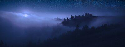 Naklejka Beautiful moonrise over the foggy mountains at night