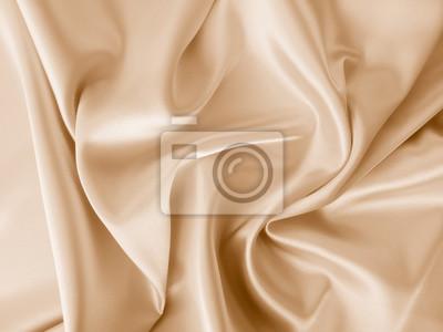 Naklejka Beautiful smooth elegant wavy beige / light brown satin silk luxury cloth fabric texture, abstract background design. Copy space.