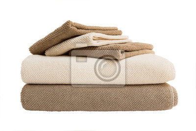 Beige and brown bath towels in stack isolated over white