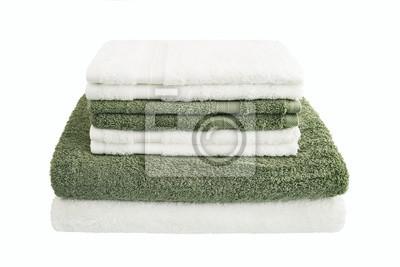 Biali i zieleni kąpielowi ręczniki w stercie odizolowywali aver bielu tło