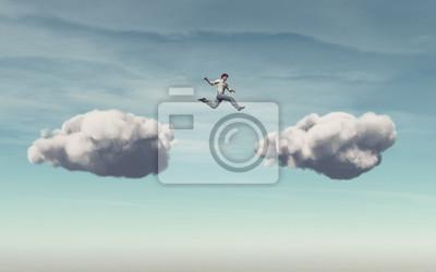 Naklejka Biznesmen skacze na chmurze