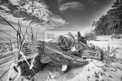 Black and white picture of an old fishing net.