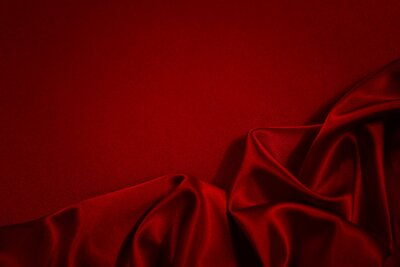 Naklejka Black red silk satin background. Copy space for text or product. Wavy soft folds on shiny fabric. Luxurious dark red background. Valentine, Christmas, Anniversary, Holiday, Celebration, Black Friday.