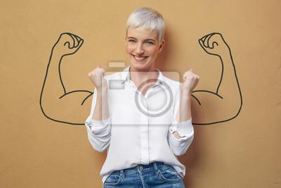 Naklejka Blond kobieta na ścianie / mięśnie / siła / moc