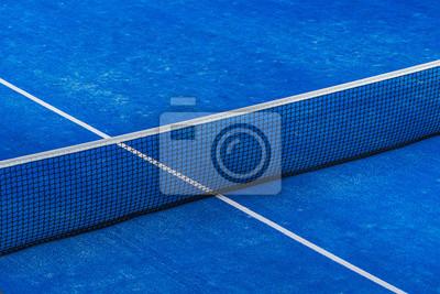 Naklejka Blue paddle tennis net and court field background