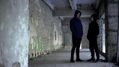 Naklejka Boys in hoodie talking in ruined building, teenage gang, young criminals