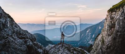 Naklejka Breathtaking Views From Mangart Peak at Stunning Sunrise. Peaks Above Clouds.